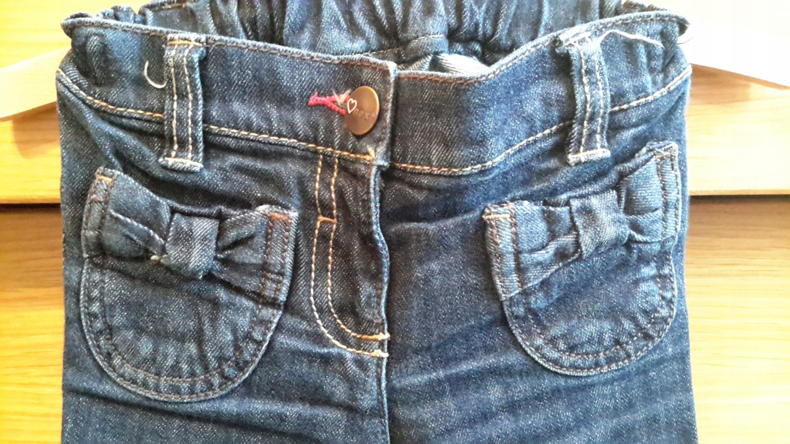 NEXT r.86 12-18 M / Jeansy z kokardkami.